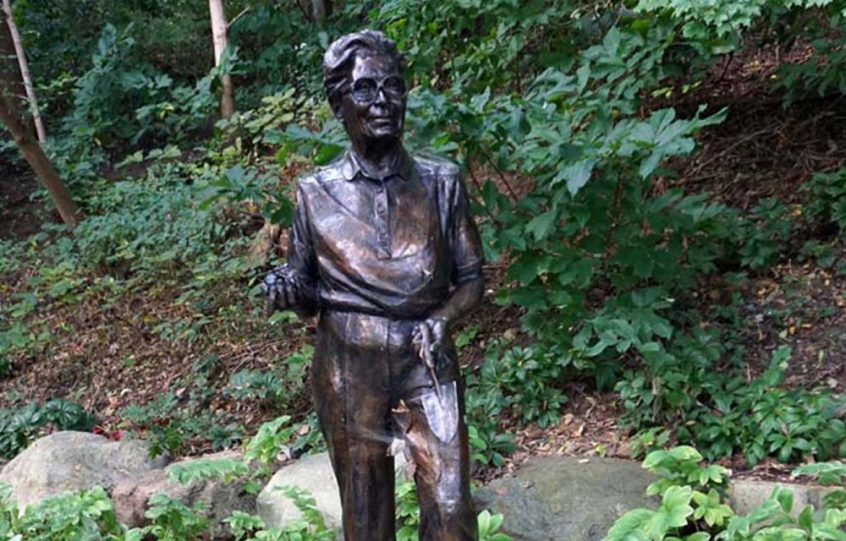Marie Aull statue in a garden