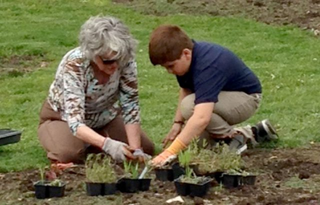 member and student planting